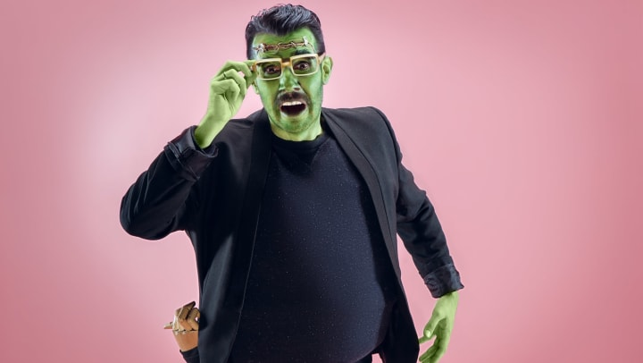 Man dressed as Frankenstein's monster, pink background