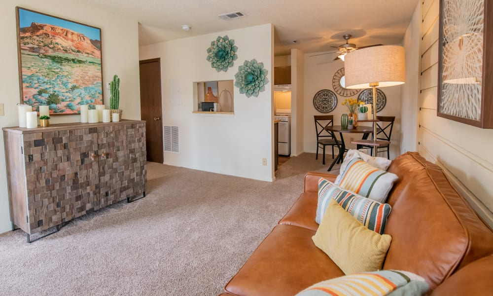 Spacious living room and dining room at Aspen Park Apartments in Wichita, Kansas