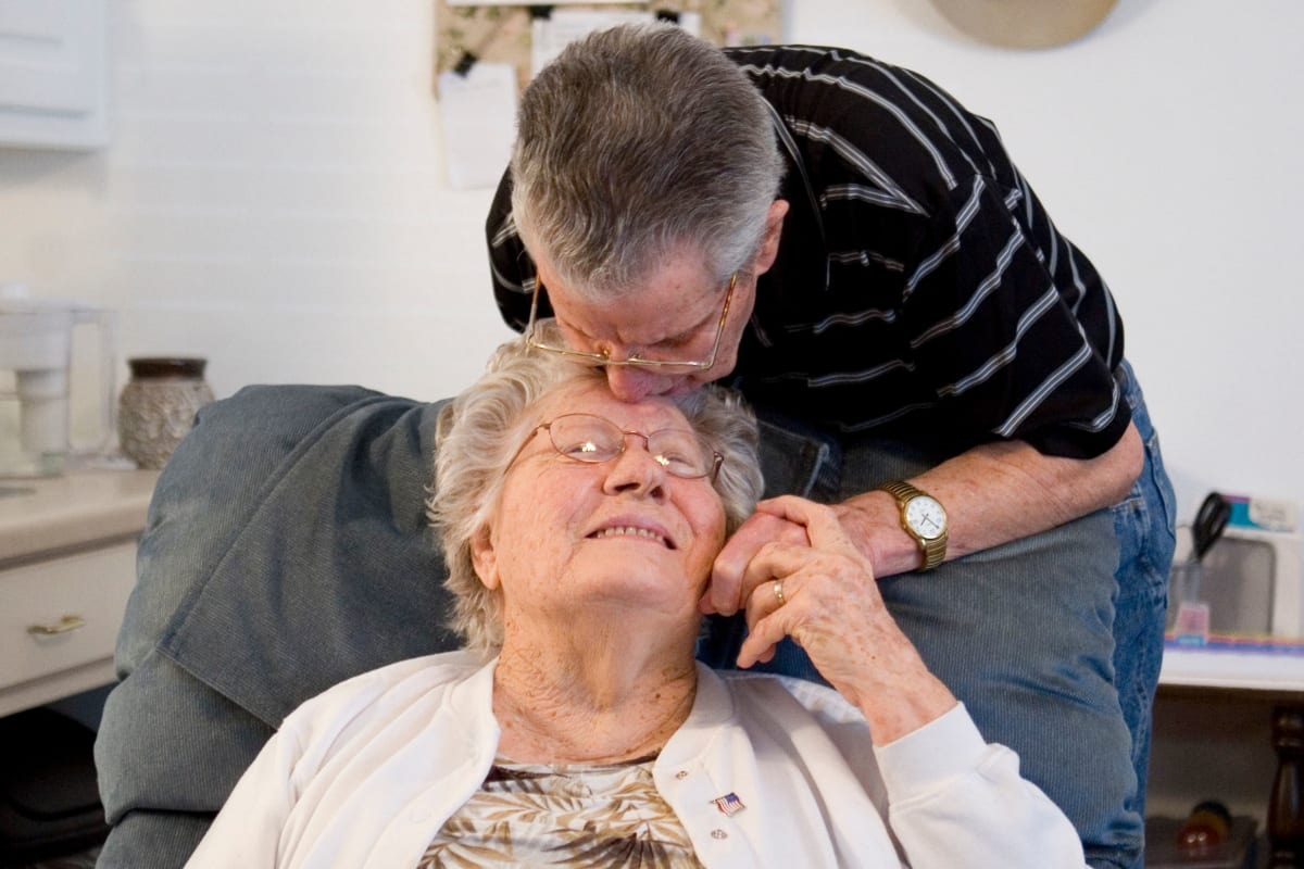 A resident and caregiver at Parsons House La Porte in La Porte, Texas