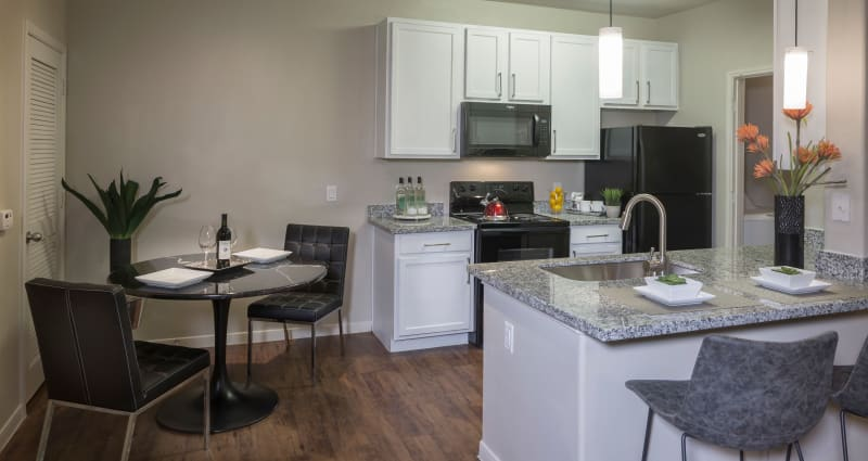 A beautiful open kitchen at Sommerall Station Apartments in Houston, Texas