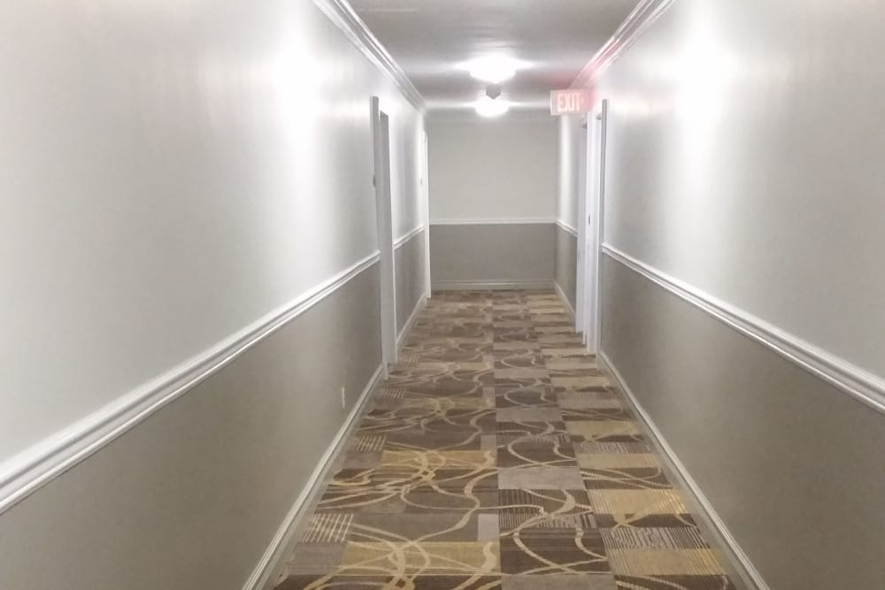 Well-lit hallway at Carlyle Towers in Caldwell, NJ