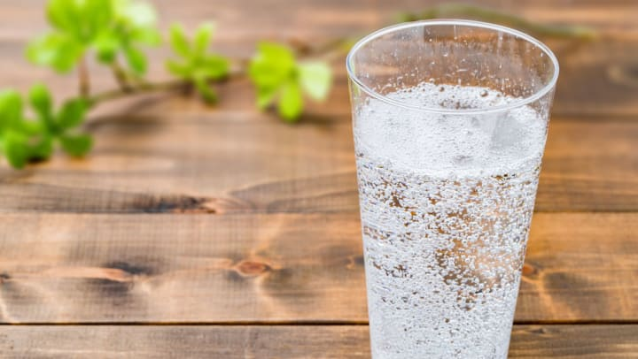 Carbonated water on wood grain background