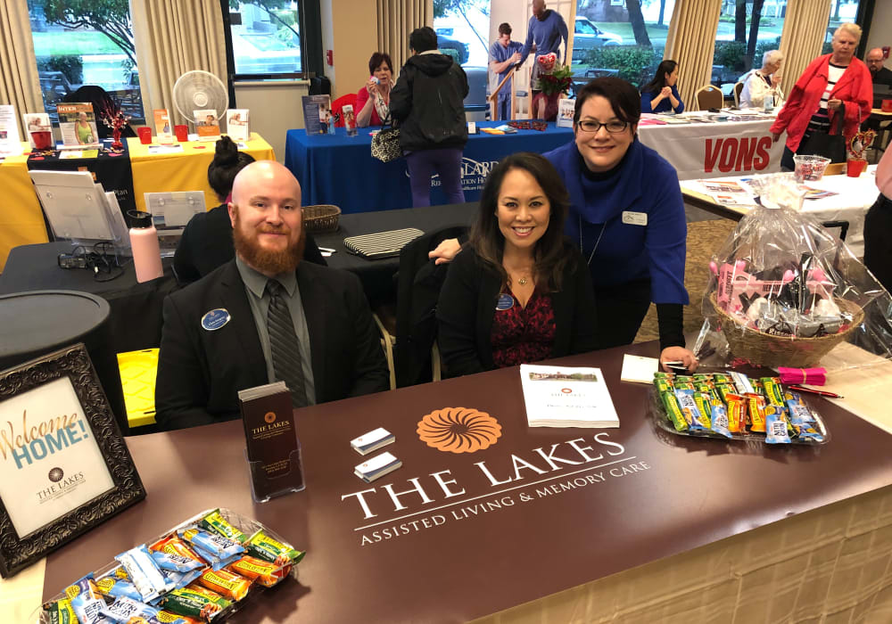 Staff members at a health fair for The Lakes at Banning in Banning, California.