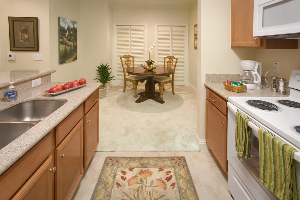 An apartment kitchen and dining room at The Village of Tanglewood in Houston, Texas
