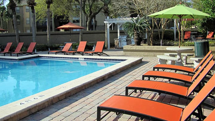 Swimming pool area at American Landmark community in Jacksonville, FL