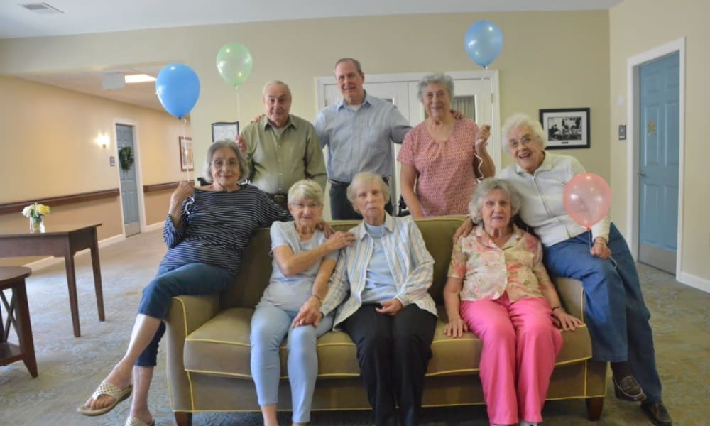 A group of residents holding balloons at Heritage Green in Mechanicsville, Virginia