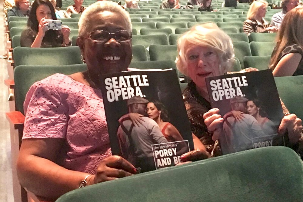 Two ladies having fun at the Seattle Opera from our senior living community in Seattle, WA
