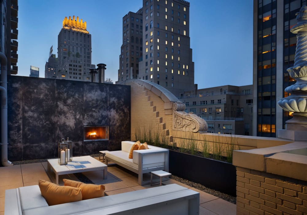 Luxurious rooftop lounge with an amazing skyline view at twilight at a high-rise extended stay property in New York by Electra America in Lake Park, Florida