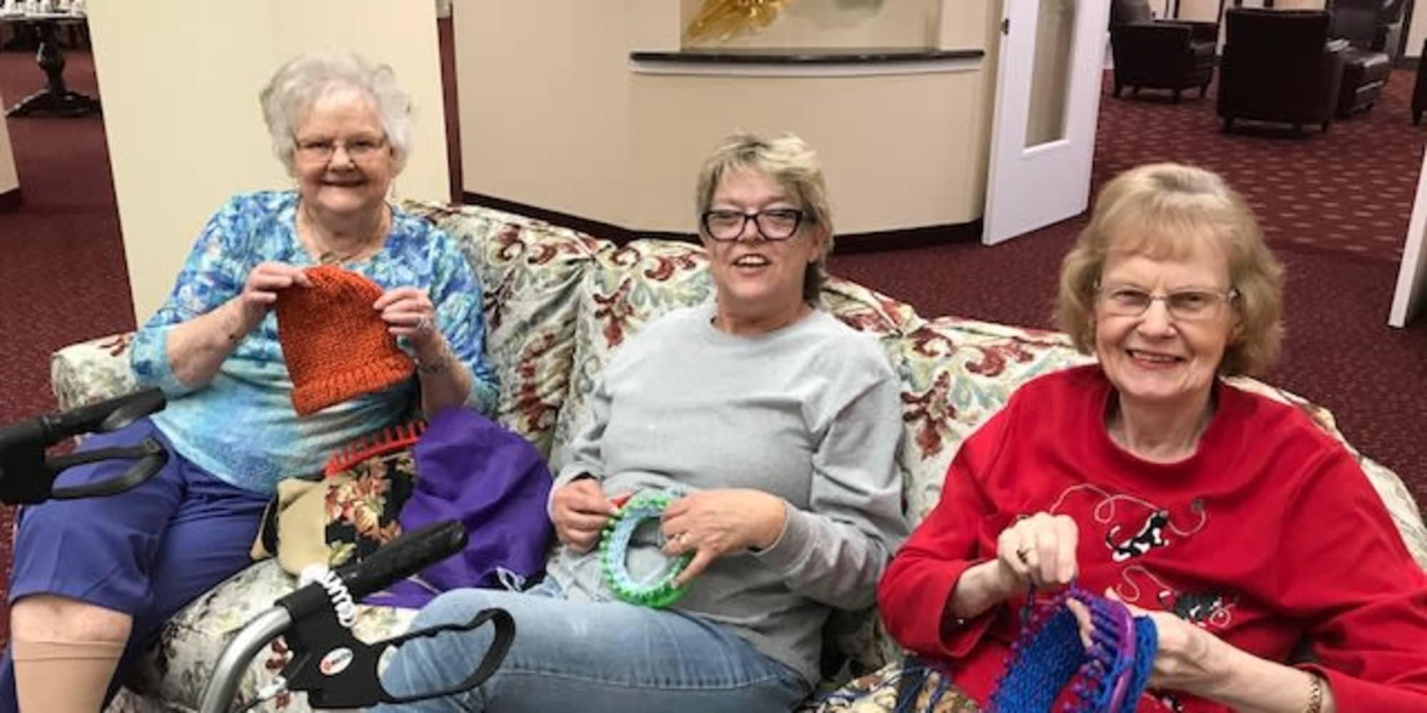 Three residents knitting hats at Meadowlark Estates Gracious Retirement Living in Lawrence, Kansas