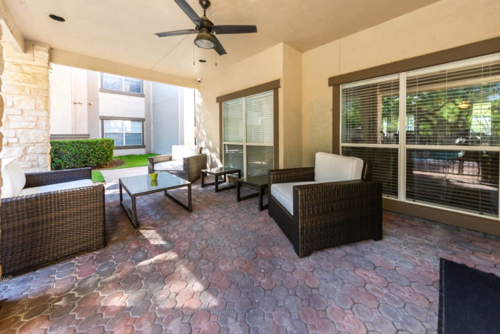 Private patio lounge area at Marquis at Ladera Vista in Austin, Texas