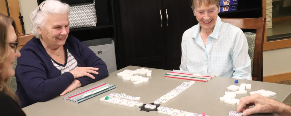 Residents playing dominos at The Springs at Greer Gardens in Eugene, Oregon