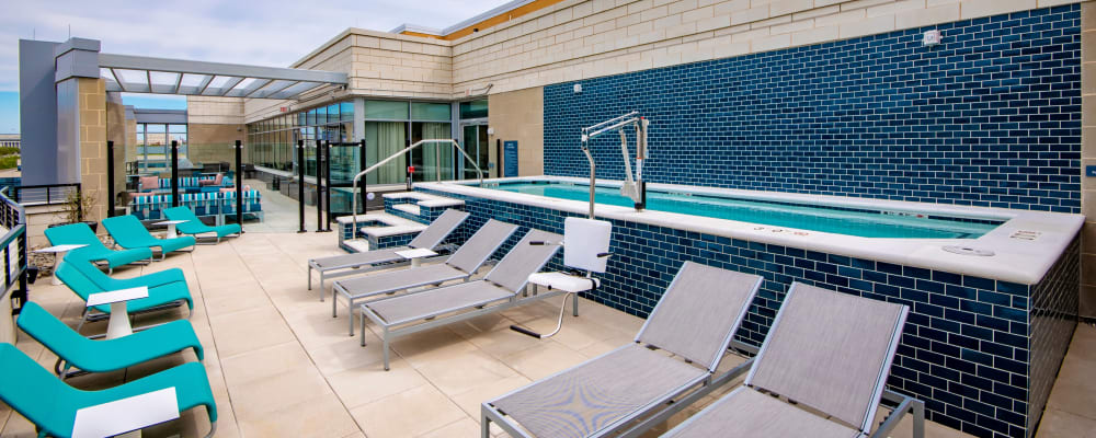 Roof-top pool with plenty of lounge chairs at Harlow in Washington, District of Columbia