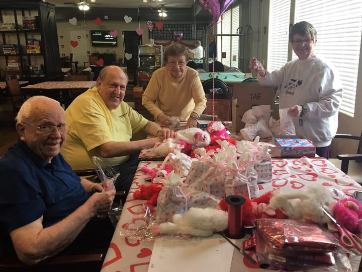 Friends making balloon grams for friends on Valentine's Day at Merrill Gardens at Siena Hills