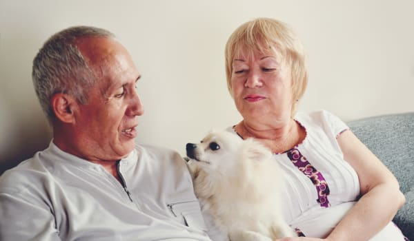 Senior couple with their small dog at Elk Meadows Assisted Living and Memory Care in Oakley, Utah