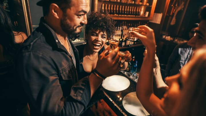 People having fun while drinking shots at a nightclub.