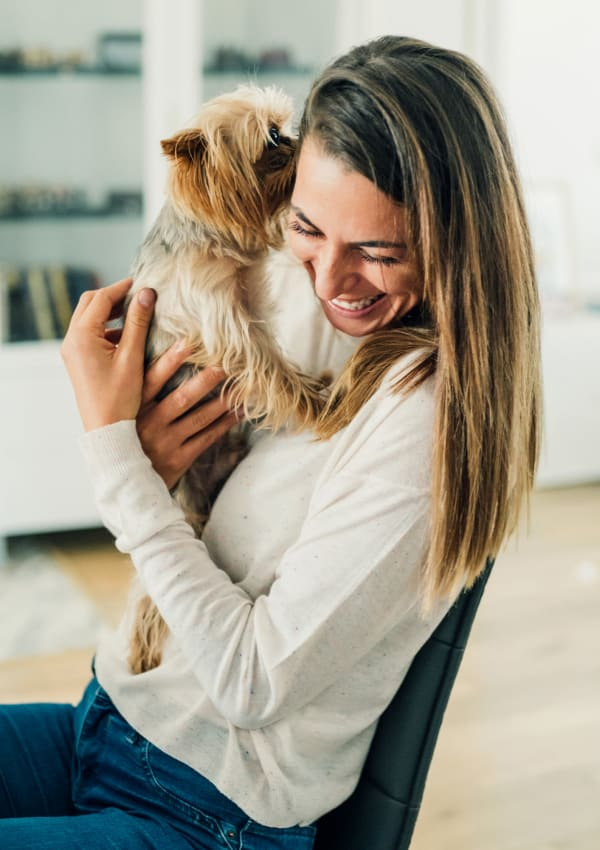 Resident hugging her pet at The Clark in Austin, Texas