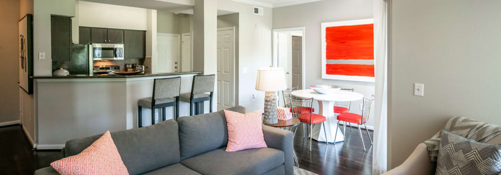 A spacious living room with neutral colors at The Fuse at Park Row in Houston, Texas