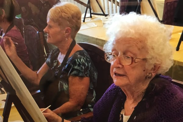 Residents enjoying the Wine & Canvas event at Discovery Senior Living in Bonita Springs, Florida