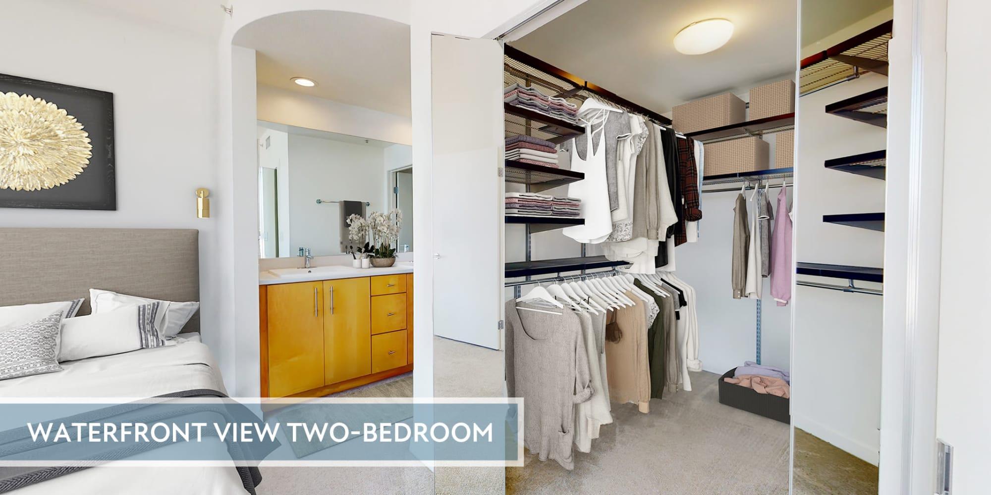 Large walk-in closet and bathroom vanity in a luxe collection home's primary bathroom at Esprit Marina del Rey in Marina del Rey, California