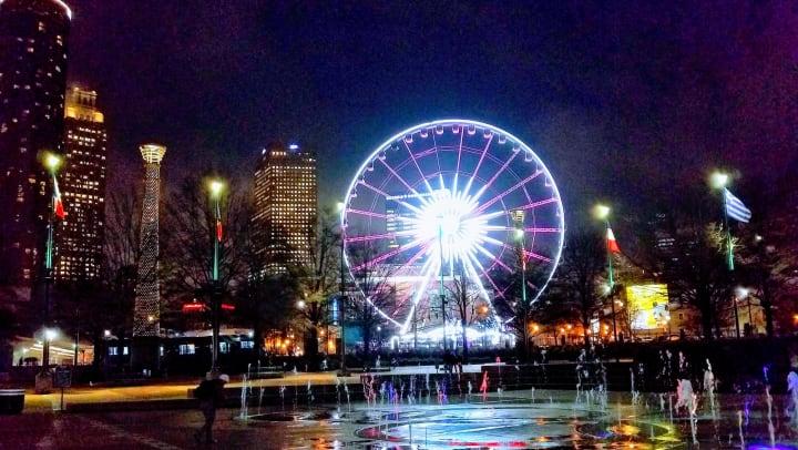 SkyView Atlanta illuminated at night.