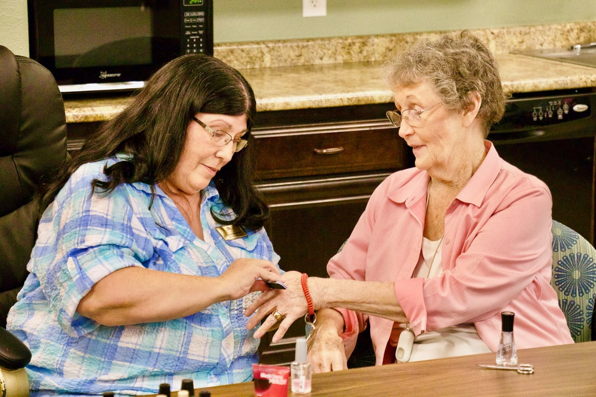 A lady enjoying a manicure at Isle at Watercrest Bryan in Bryan, Texas