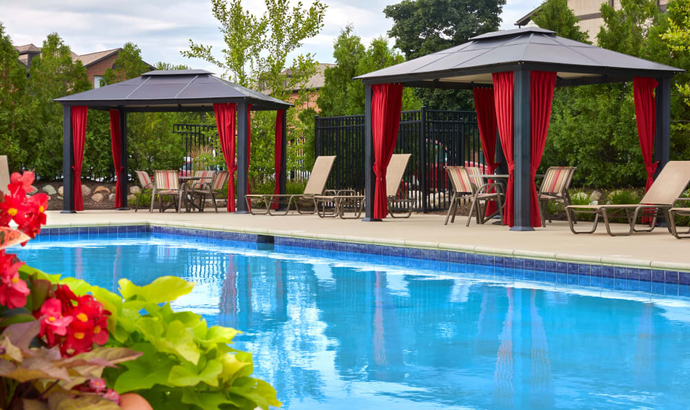 Gorgeous pool area at The Trilogy Apartments in Belleville
