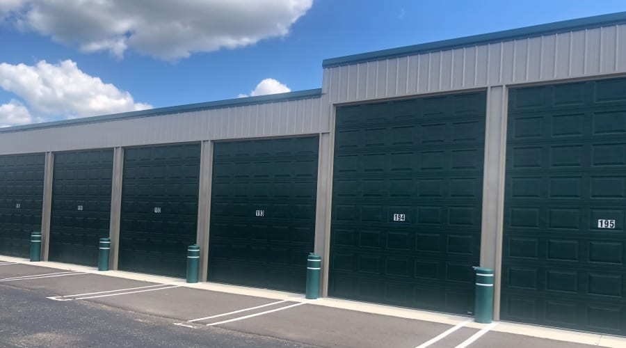 Outdoor storage units with green doors at KO Storage of Clearwater in Clearwater, Minnesota