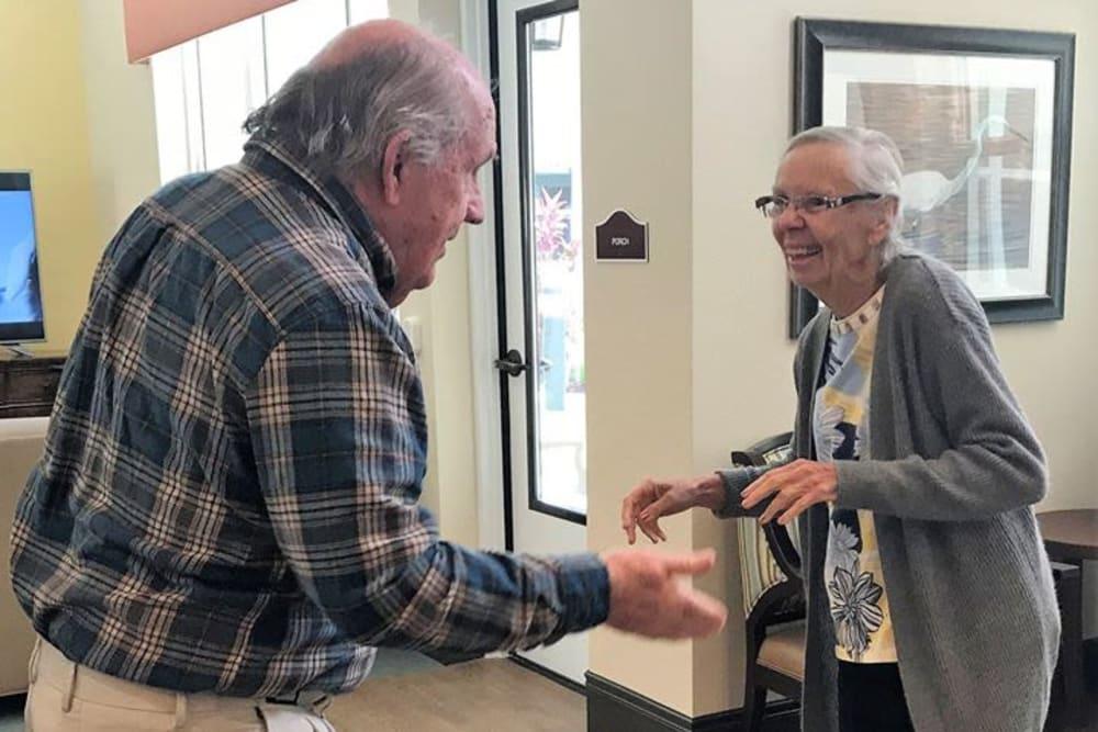 two senior residents dancing