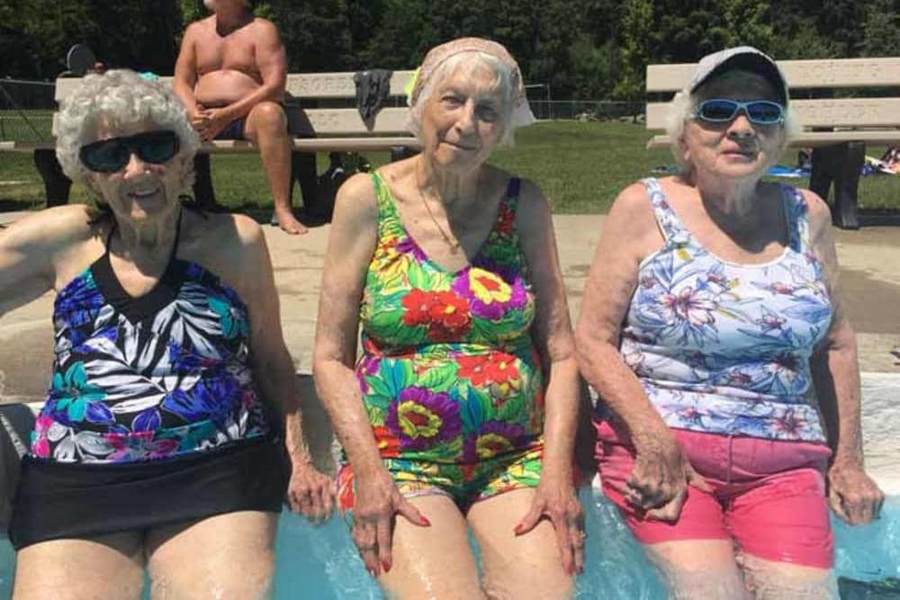3 residents sitting side by side at Heritage Hill Senior Community in Weatherly, Pennsylvania