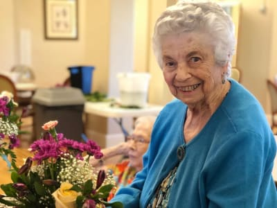 Happy senior woman at Eastern Star Masonic Retirement Campus in Denver, CO