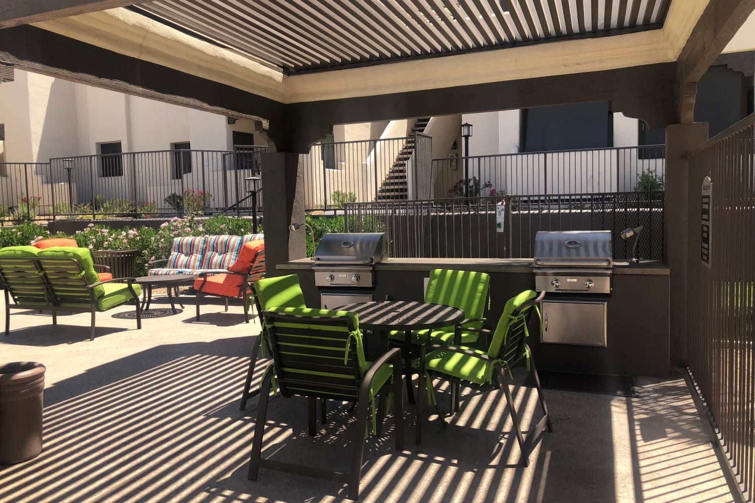 Outdoor seating in the courtyard at Casa Santa Fe Apartments in Scottsdale, Arizona