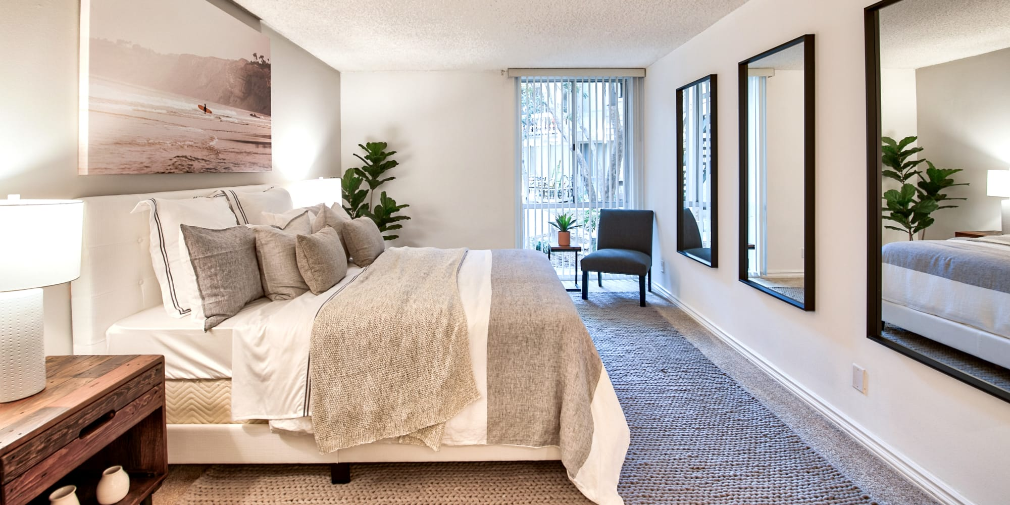 Main bedroom with a large bay window at The Meadows in Culver City, California