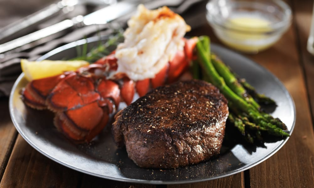 A freshly prepared steak and seafood meal at Keystone Place at Richland Creek in O'Fallon, Illinois