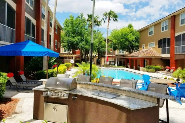 Community grill overlooking the swimming pool at Amara at MetroWest in Orlando, Florida