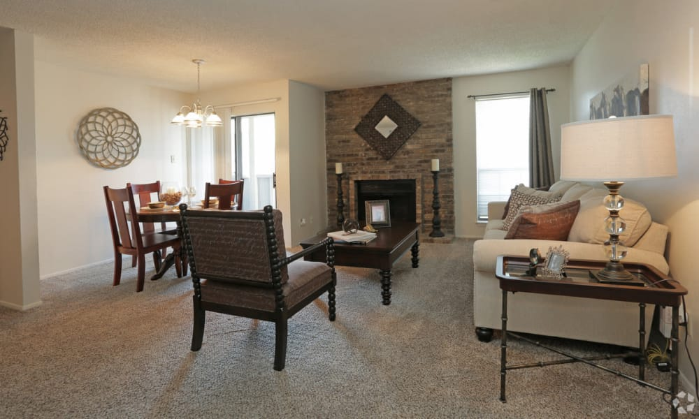 Living room with fireplace at High Ridge Apartments in El Paso, Texas