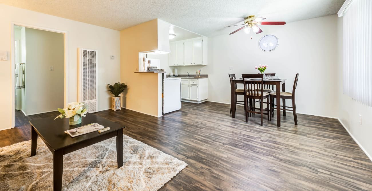 Open living floor plan with wood flooring at Cypress Point in Northridge, CA