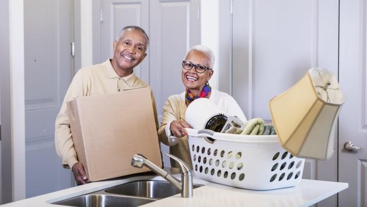 Senior Couple Organizing Belongings