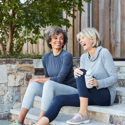 Residents having a laugh on their steps after going for a jog in the neighborhood at Sofi at Somerset in Bellevue, Washington