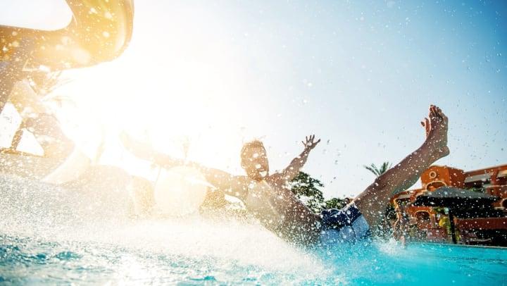 Man having fun on waterslide at amusement park.