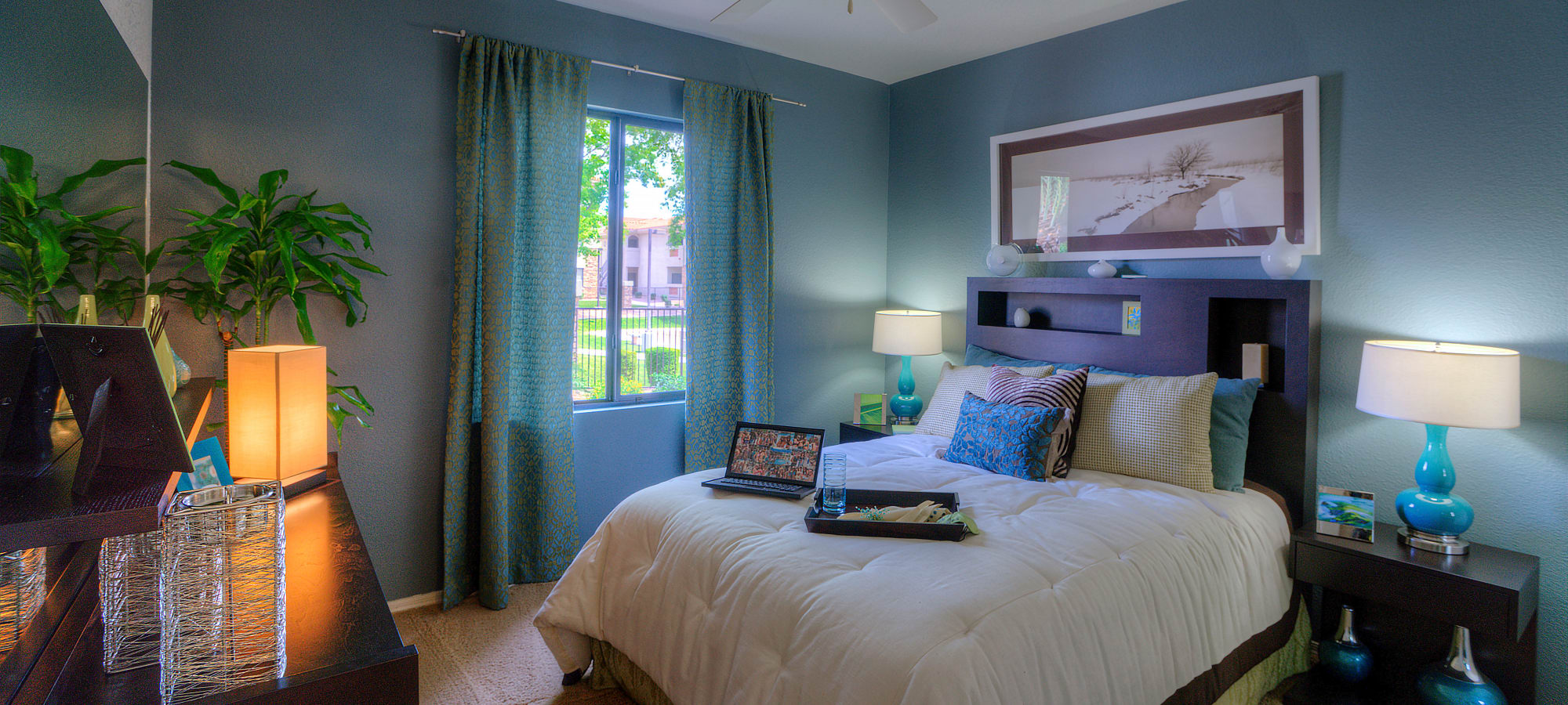 Beautifully decorated master bedroom in model home at San Marbeya in Tempe, Arizona