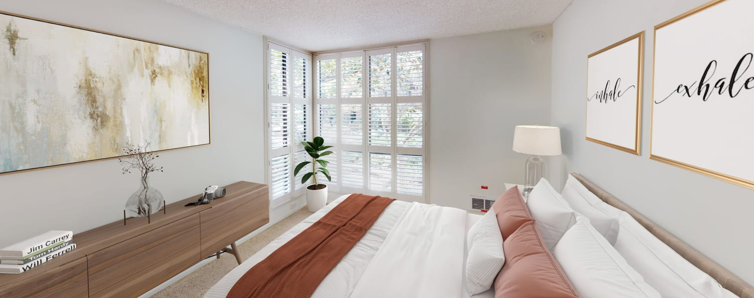 Bay windows and plush carpeting in a apartment home's bedroom at Mariners Village in Marina del Rey, California