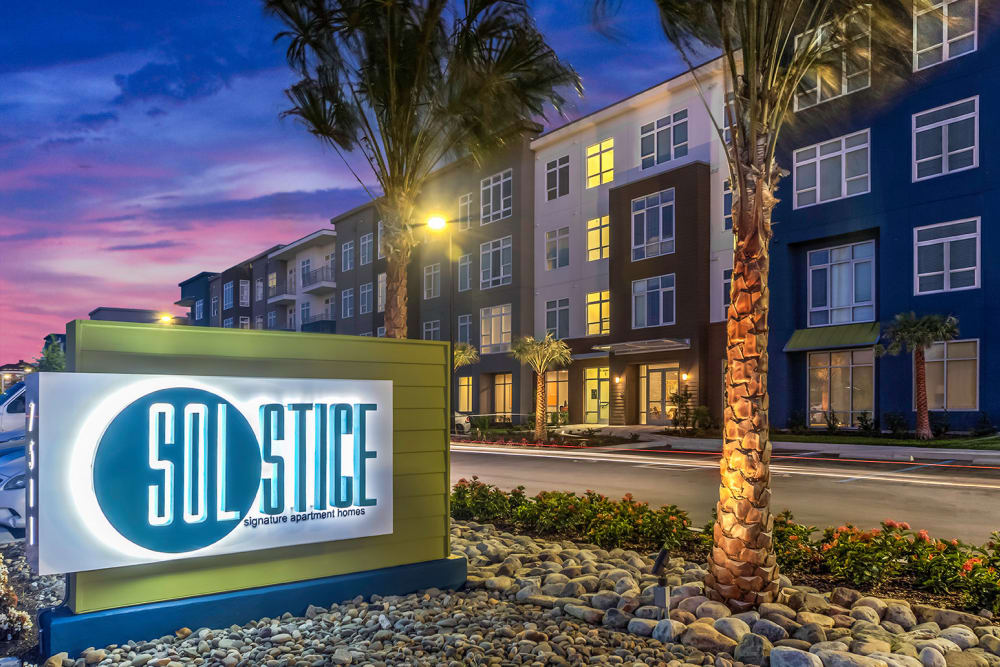 Exterior view at night of Solstice Signature Apartment Homes in Orlando, FL