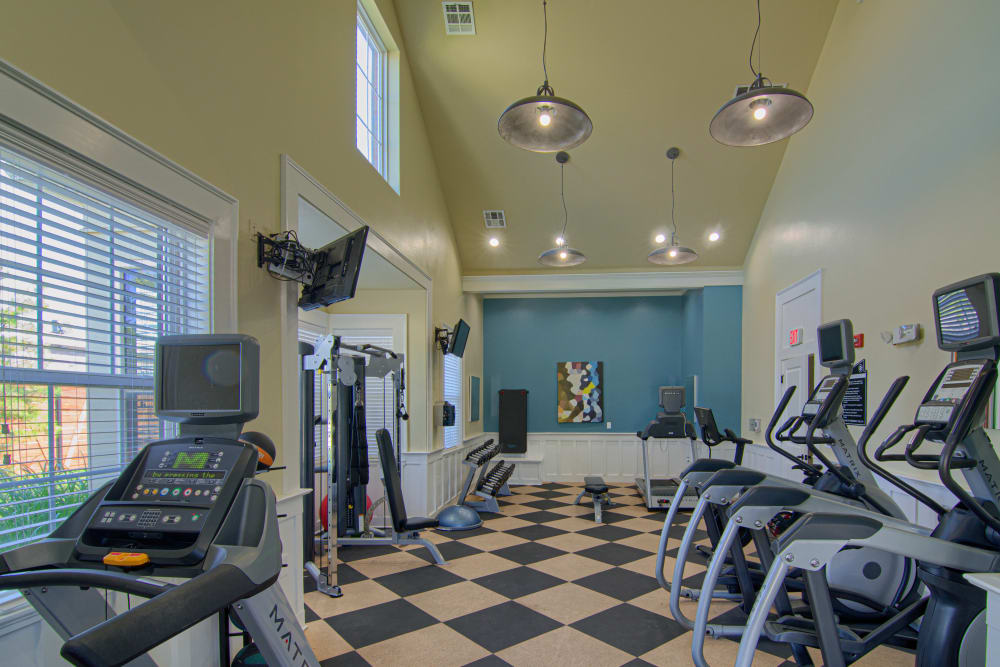 Fitness center with cardio machines at Traditions at Westmoore in Oklahoma City, Oklahoma.