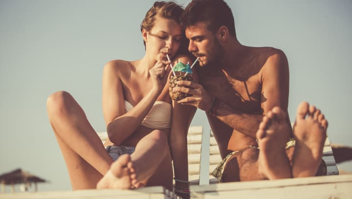 Resident couple sipping a cocktail together at a beach near Olympus at the District in South Jordan, Utah