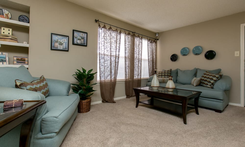Carpeted living room at Walnut Ridge Apartments in Corpus Christi, Texas