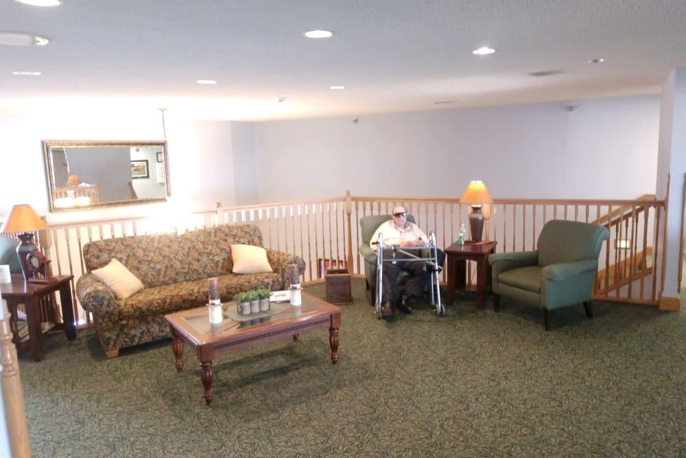 Resident in a sitting area at Whispering Oak Place in Ellendale, Minnesota