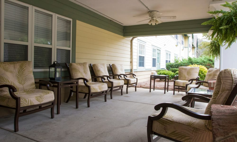 Front porch with seating at The Legacy at Southpointe Drive in Greenville, South Carolina