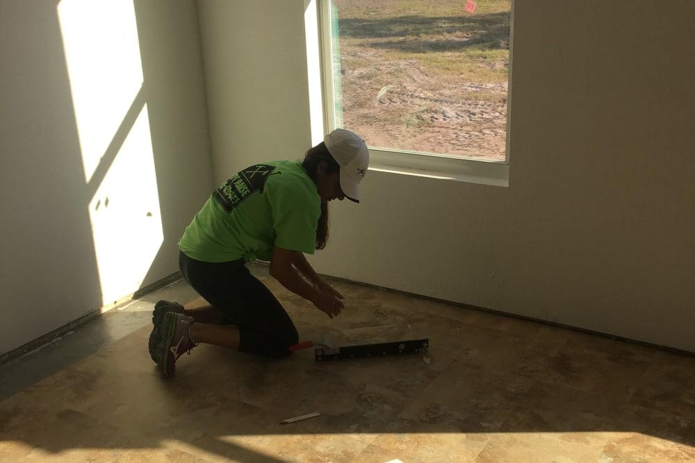A man sweeping the floor near Discovery Senior Living in Bonita Springs, Florida