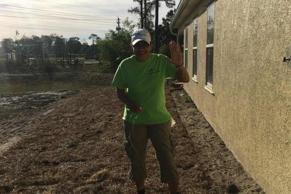 A man standing near an unfinished house near Discovery Senior Living in Bonita Springs, Florida