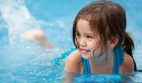 A young girl playing in the pool at Summer Park Apartments in Jackson, Mississippi